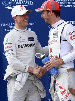 Michael Schumacher, Mercedes GP with Jenson Button, Mclaren