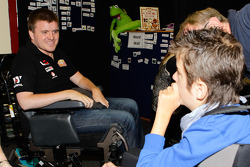 Team I-Select owner Lucas Dumbrell visits Newstead Heights special needs students