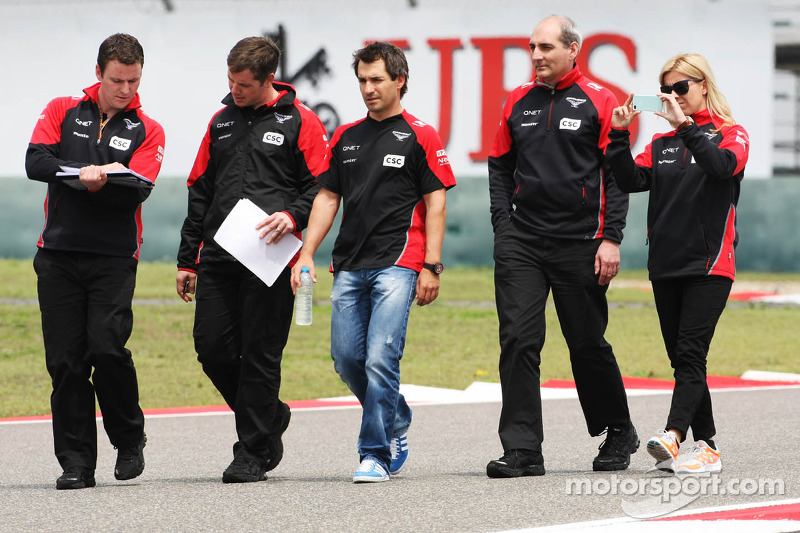 Timo Glock, Marussia F1 Team walks the circuit with Maria De Villota, Marussia F1 Team Test Driver