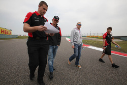 Charles Pic, Marussia F1 Team walks the circuit with Olivier Panis,