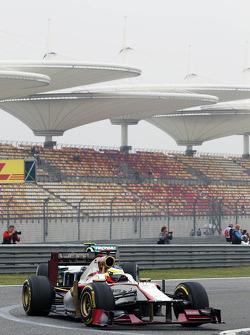 Pedro De La Rosa, HRT Formula 1 Team leads Nico Rosberg, Mercedes AMG F1