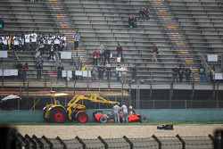 Timo Glock, Marussia F1 Team crashed at turn one in the first practice session