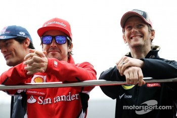 Fernando Alonso, Scuderia Ferrari with Romain Grosjean, Lotus F1 Team on the drivers parade
