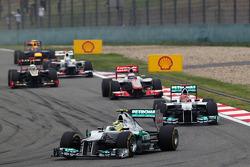 Nico Rosberg, Mercedes AMG F1 leads Michael Schumacher, Mercedes AMG F1