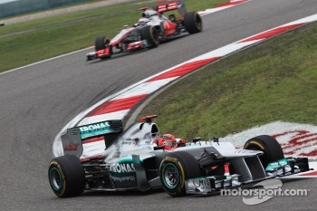 Michael Schumacher, Mercedes AMG F1 leads Jenson Button, McLaren