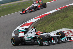 Michael Schumacher, Mercedes AMG F1 leads Jenson Button, McLaren