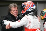 Norbert Haug, Mercedes Sporting Director celebrates with Jenson Button, McLaren