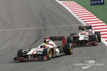 Pedro De La Rosa, HRT Formula 1 Team leads team mate Narain Karthikeyan, HRT Formula One Team HRT