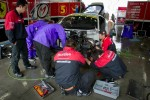 Work on the #5 Team Mach Ferrari 458 GT3 after the morning crash