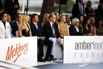HSH Prince Albert of Monaco, and Princess Charlene of Monaco with Bernie Ecclestone, CEO Formula One Group, and Fabiana Flosi, at the Amber Lounge Fashion Show