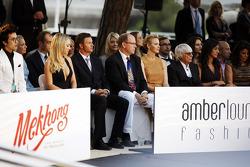 HSH Prince Albert of Monaco, and Princess Charlene of Monaco with Bernie Ecclestone, CEO Formula One Group, and Fabiana Flosi, at the Amber Lounge Fashion Show