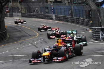 Mark Webber, Red Bull Racing leads the race from Nico Rosberg, Mercedes AMG F1