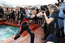 Race winner Mark Webber, Red Bull Racing celebrates with the team on the Red Bull Energy Station
