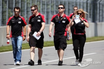 Timo Glock, Marussia F1 Team, and Maria De Villota, Marussia F1 Team Test Driver, walk the circuit