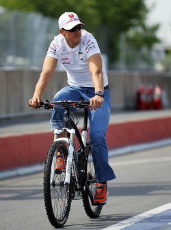 Michael Schumacher, Mercedes AMG F1 on a bicycle