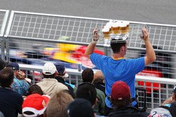 Mark Webber, Red Bull Racing passes a beer seller in the grandstand