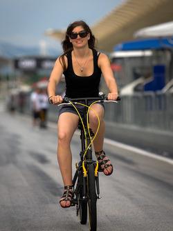 Cyndie Allemann rides her bike to track inspection