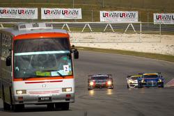 #21 Hitotsuyama Racing Audi R8 LMS: Cyndie Allemann, Akihiro Tsuzuki and #1 Mola Nissan GT-R: Masataka Yanagida, Ronnie Quintarelli with the Circuit Safari bus