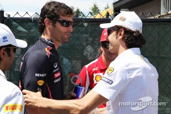 Mark Webber, Red Bull Racing with Pedro De La Rosa, HRT Formula 1 Team