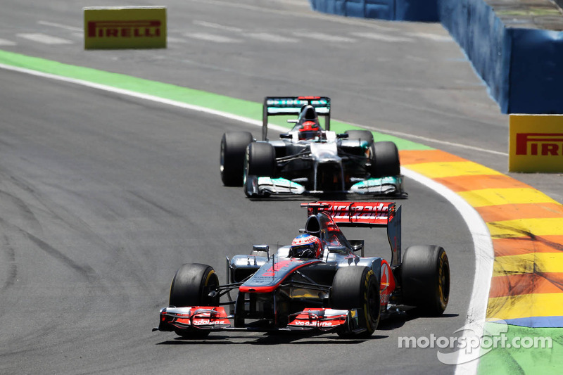 Jenson Button, McLaren Mercedes leads Michael Schumacher, Mercedes AMG F1