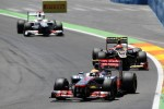 Lewis Hamilton, McLaren Mercedes leads Romain Grosjean, Lotus F1