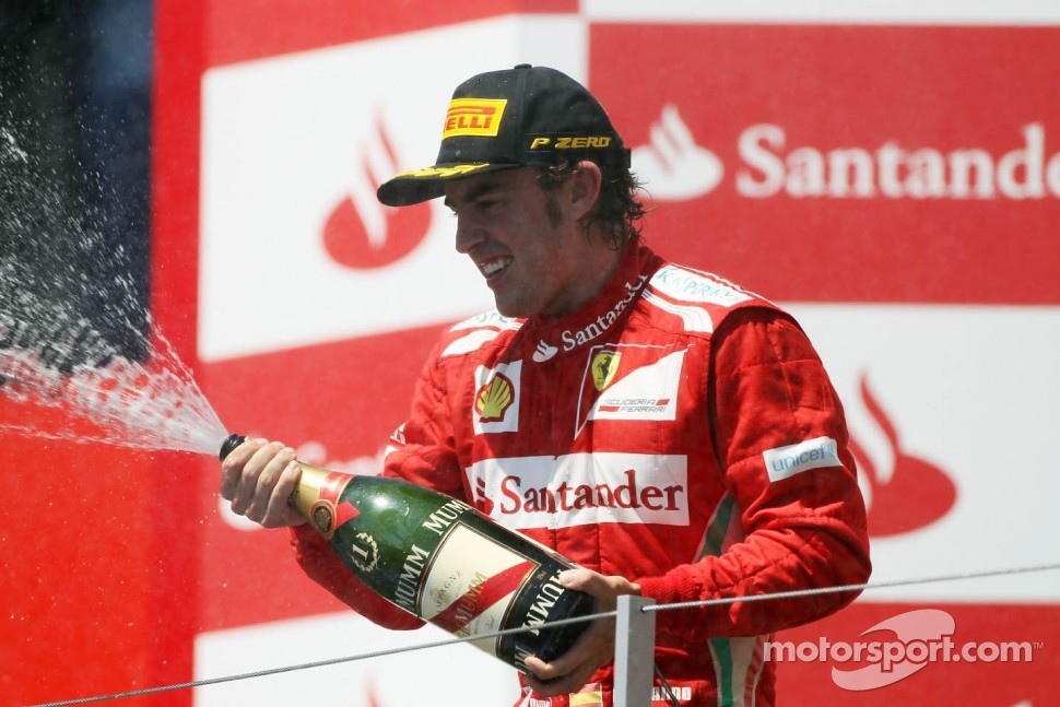 European GP race winner Fernando Alonso, Ferrari celebrates on the podium