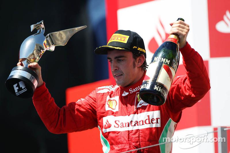 Race winner Fernando Alonso, Ferrari celebrates on the podium