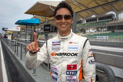 GT300 pole winner Tomonobu Fujii celebrates
