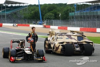 Romain Grosjean, Lotus F1 E20 with the Tumbler vehicle from the Batman movie The Dark Night Rises