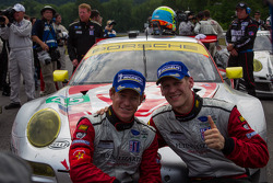 Jörg Bergmeister and Patrick Long after winning GT