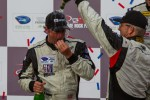 Joe Foster celebrating with Patrick Dempsey after podium finish