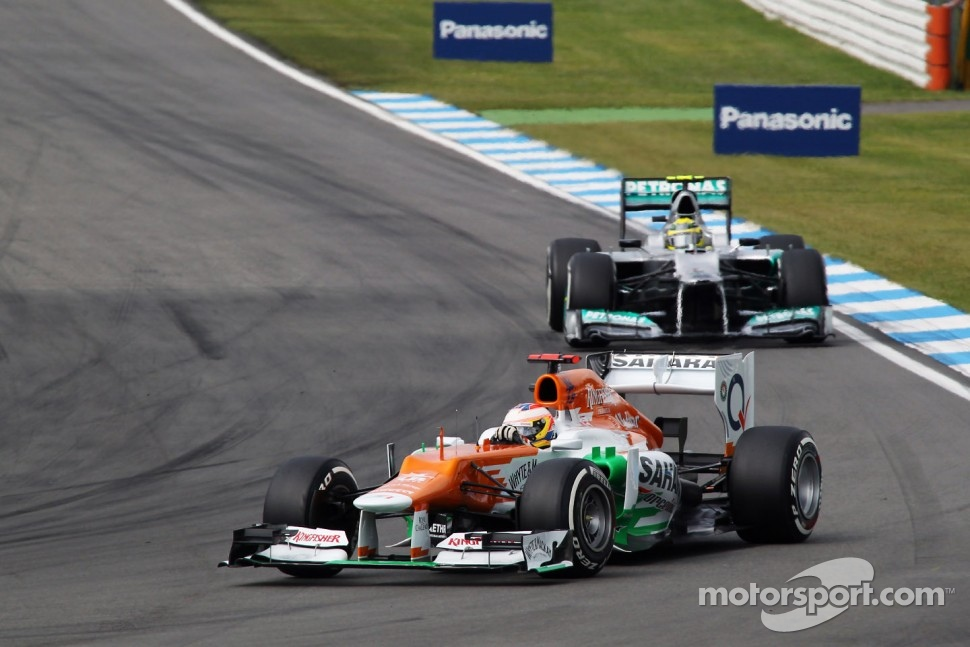 Paul di Resta, Sahara Force India leads Nico Rosberg, Mercedes AMG F1