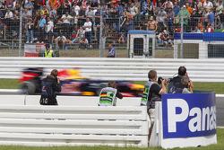 Photographers take pictures of Sebastian Vettel, Red Bull Racing