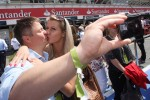 A couple kissing in the pit lane