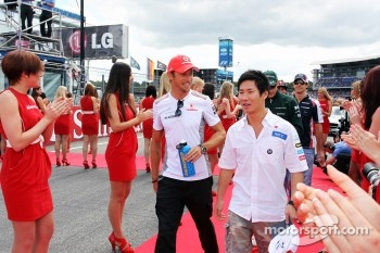 Jenson Button, McLaren with Kamui Kobayashi, Sauber on the drivers parade
