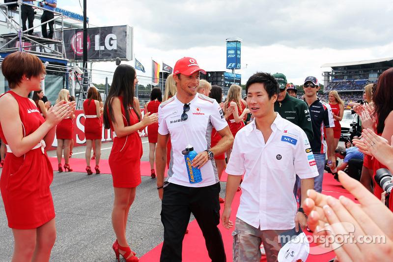 Jenson Button, McLaren with Kamui Kobayashi, Sauber on the drivers parade