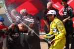 Victory lane: winner Helio Castroneves, Team Penske Chevrolet and his team