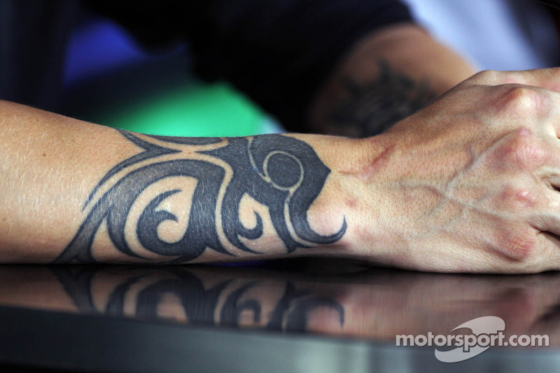 A tattoo on the arm of Kimi Raikkonen, Lotus F1 Team in the FIA Press Conference at Hungarian GP