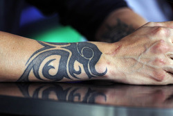 A tattoo on the arm of Kimi Raikkonen, Lotus F1 Team in the FIA Press Conference