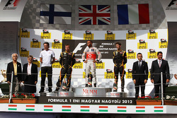 The podium, Kimi Raikkonen, Lotus F1 Team, second; Lewis Hamilton, McLaren, race winner; Romain Grosjean, Lotus F1 Team, third