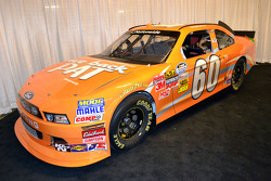Trevor Bayne poses with a tribute car for Pat Summitt, legendary women's basketball coach at Tennessee ahead of the Bristol race