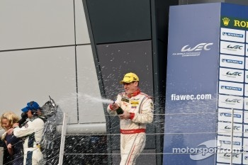 Enzo Potolicchio sprays champagne
