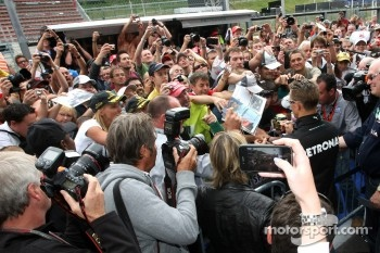 Michael Schumacher, Mercedes GP  signing autographs for the fans
