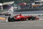 A crash at the start involving Fernando Alonso, Ferrari