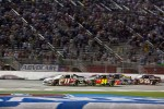 Denny Hamlin, Joe Gibbs Racing Toyota gets a push from Jeff Gordon, Hendrick Motorsports Chevrolet