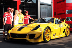 Benjamin Sloss Treynor, Vice-President Google Management Group is presented with a Ferrari 512 he won in an auction to raise funds for victims of the Italian earthquake by Luca di Montezemolo, Ferrari President; Fernando Alonso, Ferrari; and Felipe Massa,