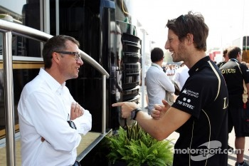 Eric Lux, Genii Capital CEO with Romain Grosjean, Lotus F1 Team, serving a one race ban