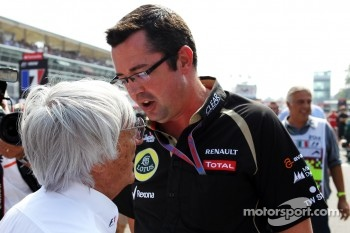 Eric Boullier, Lotus F1 Team Principal with Bernie Ecclestone, CEO Formula One Group, on the grid
