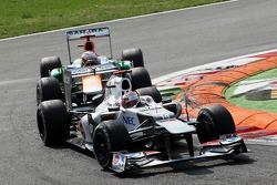 Kamui Kobayashi, Sauber leads Paul di Resta, Sahara Force India