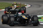 Vitaly Petrov, Caterham leads Jerome d'Ambrosio, Lotus F1